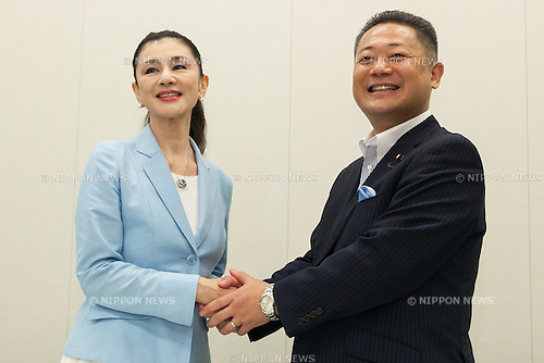 (L to R) Actress Mitsuko Ishii and Osaka Restoration Association Secretary-General Nobuyuki Baba, shake hands during a press conference at the House of Representatives building  number 1 on June 9, 2016, Tokyo, Japan. The Osaka Restoration Association, also known as One Osaka announced the official candidacy of actress Mitsuko Ishii for July's House of Councillors elections. (Photo by Rodrigo Reyes Marin/AFLO)