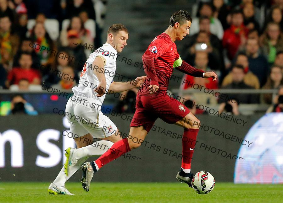 Cristiano Ronaldo Branislav Ivanovic Uefa EURO 2016 qualifying football match between Portugal and Serbia in Lisboa, Portugal on March 29. 2015.  (credit image & photo: Pedja Milosavljevic / STARSPORT)