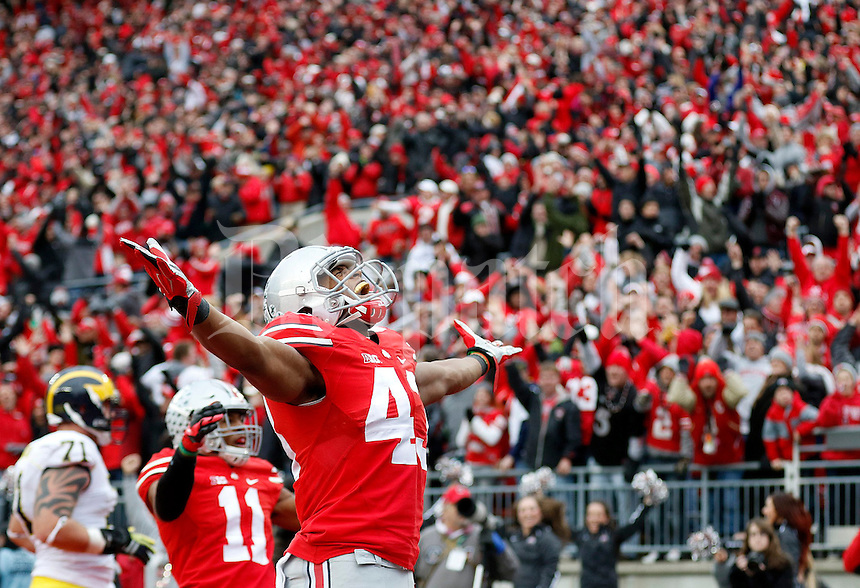 Ohio State Buckeyes linebacker Darron Lee (43) celebrates after returning a fumble for a touchdown during the fourth quarter of the NCAA football game against Michigan at Ohio Stadium on Saturday, November 29, 2014. (Columbus Dispatch photo by Jonathan Quilter)