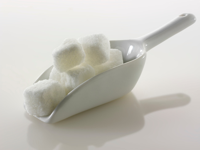 Rough cut white refined sugar cubes