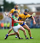 Conor Harrison of Clooney-Quin in action against Cathal Malone of  Sixmilebridge during their senior county final replay at Cusack park. Photograph by John Kelly.