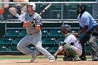 5 June 2010:  FIU's Tim Jobe (26) singles in the fifth inning as the Dartmouth Green Wave defeated the FIU Golden Panthers, 15-9, in Game 3 of the 2010 NCAA Coral Gables Regional at Alex Rodriguez Park in Coral Gables, Florida.