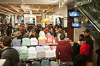 Shoppers in the American Eagle Outfitters store in the Herald Square shopping district in New York looking for bargains on Thanksgiving Day, Thursday, November 24, 2011. Many retailers are opening their doors on Thanksgiving or opening up for Black Friday the night before. (© Richard B. Levine)