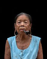 A 89 year old minority women from the Thet Tribe in the Sinshasite Village, smoking a Pipe, Mrauk U, Rakine State, Myanmar