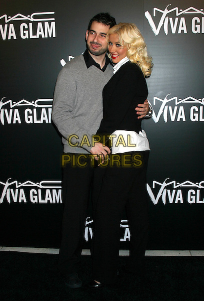 JORDAN BRATMAN & CHRISTINA AGUILERA.The M.A.C. Viva Glam VI dinner to benefit Aids research at Cedar Lake in New York City, NY, USA..September 6th, 2006.Ref: IW.full length black jacket trousers white shirt grey gray jumper husband wife married couple.www.capitalpictures.com.sales@capitalpictures.com.©Ian Wilson/Capital Pictures