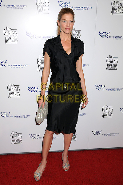 TRICIA HELFER .24th Annual Genesis Awards - Arrivals held at the Beverly Hilton Hotel, Beverly Hills, California, USA, 20th March 2010..full length black dress belt silver gold clutch bag sandals strappy .CAP/ADM/BP.©Byron Purvis/AdMedia/Capital Pictures.