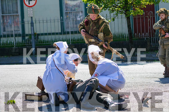 Listowel Military Tattoo: Red Cross nurses attending a wounded US soldier during the mock World War 2 battle in the Square on Sunday last.