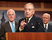 United States Senator Chuck Grassley (Republican of Iowa) answers a reporter's question at a Republican press conference in the US Capitol in Washington, DC after members of the US Senate viewed the latest FBI report on Judge Brett Kavanaugh on Thursday, October 4, 2018. Looking on from the right is US Senator Orrin Hatch (Republican of Utah).<br /> Credit: Ron Sachs / CNP<br /> (RESTRICTION: NO New York or New Jersey Newspapers or newspapers within a 75 mile radius of New York City)