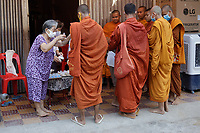 Battambang - Cambodia - June 2020<br />  - Riverside in early morning.Monks collecting alms
