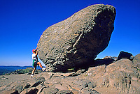 Girl climb erratic boulder Lassen National Park Califonia