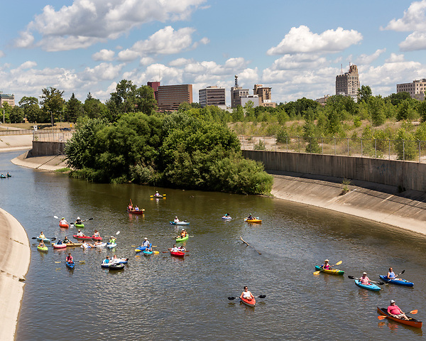 August 6, 2016. Flint, Michigan.<br />  The 3rd annual Flint River Flotilla was held to raise awareness about the river, it was not the cause of the water crisis, and brought hundreds of people to the river for a several mile float. <br />  In April 2014, the city of Flint switched its water source from the Detroit Water and Sewerage Department to using the Flint River in an effort to save money. When the switch occurred, the city failed to have corrosion control treatment in place for the new water. This brought about a leaching of lead from pipes into the water, increasing the lead content in the drinking water to levels far above legal limits. After independent sources brought this to light, the city admitted the water was unsafe and legal battles have ensued between resident and the local and state governments.