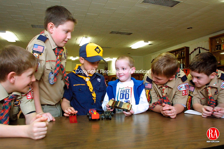 TORRINGTON, CT 1/31/01--0131TK09.tif  Members of the Cub Scout Pack 50 surround visitor Luke Pepper(center) showing recent Luke Pepper,5, accepted a donation of $261 in behalf of the Cystic Fibrosis foundation from Cub Scout Pack 50 at the Burrville Firehouse Wednesday night. The Cub Scouts raised money during the recent holiday season by wrapping gifts at Borders in Simsbury to earn money for a donation to the Cystic Fibrosis foundation. Scouts looking one are Tracy Breen,10, Michael Smith,10, John Stankiewicz,7, Luke Pepper,5, Brian Cadarr,10, and Jordan Murphy,10. TOM KABELKA staff photo for REPORTERS NAME / STANDALONE PHOTO