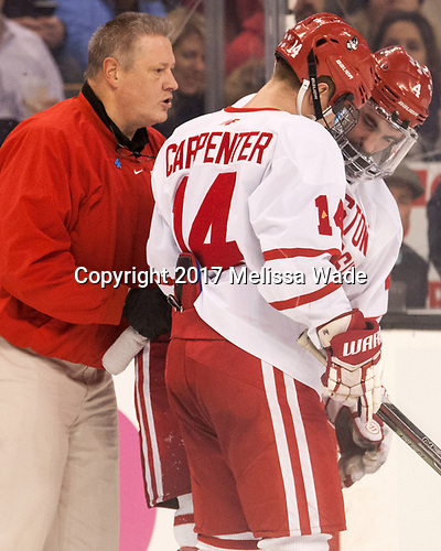 Larry Venis (BU - Assistant Director-Athletic Training Services), Bobo Carpenter (BU - 14), Brandon Hickey (BU - 4) - The Harvard University Crimson defeated the Boston University Terriers 6-3 (EN) to win the 2017 Beanpot on Monday, February 13, 2017, at TD Garden in Boston, Massachusetts.