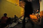 Eritrean asylum-seekers prepare for a night sleep outside their temporary shelter in southern Tel Aviv, Israel.