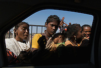 The view from the car window, central Mumbai, faces... beggars on the street,India
