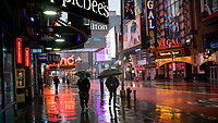 NEW YORK, NY - April 13:  People walk around local stores that remain shuttered due to COVID-19 at Times Square on April 13, 2020. in New York, United States. The global economy is facing the worst collapse since the WWII, while COVID-19  pandemic has now killed more than 22,000 people in the United States and at least 1,864,629 people died world wide. (Photo by Eduardo MunozAlvarez/VIEWpress)