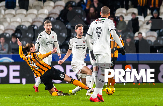 Hull City's midfielder Jackson Irvine (4) tackles Sheffield United's midfielder Chris Basham (6) during the Sky Bet Championship match between Hull City and Sheff United at the KC Stadium, Kingston upon Hull, England on 23 February 2018. Photo by Stephen Buckley / PRiME Media Images.