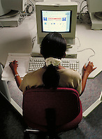 College student at computer work station. student at computer. Houston Texas, University of Houston.