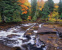 Porcupine Mountains Wilderness State Park, MI<br /> Presque Isle River and leaf covered sculpted shale above Manido Falls in autumn