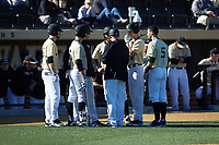 Wake Forest Demon Deacons volunteer assistant Joey Hammond (29) holds a meeting during the game against the Gardner-Webb Runnin' Bulldogs at David F. Couch Ballpark on February 18, 2018 in  Winston-Salem, North Carolina. The Demon Deacons defeated the Runnin' Bulldogs 8-4 in game one of a double-header.  (Brian Westerholt/Four Seam Images)