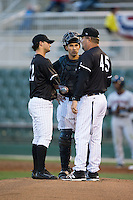 Kannapolis Intimidators pitching coach Brian Drahman (45) chats with starting pitcher Ryan Riga (12) and catcher Seby Zavala (21) during the game against the Hickory Crawdads at Kannapolis Intimidators Stadium on April 8, 2016 in Kannapolis, North Carolina.  The Crawdads defeated the Intimidators 8-2.  (Brian Westerholt/Four Seam Images)