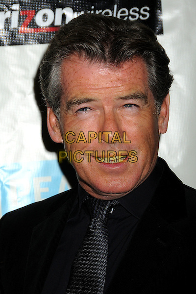 PIERCE BROSNAN .Attending the 38th Annual Peace Over Violence Humanitarian Awards held at The Beverly Hills Hotel, Beverly Hills, California, USA, 6th November 2009..portrait headshot black velvet tie shirt mouth open .CAP/ADM/BP.©Byron Purvis/AdMedia/Capital Pictures.