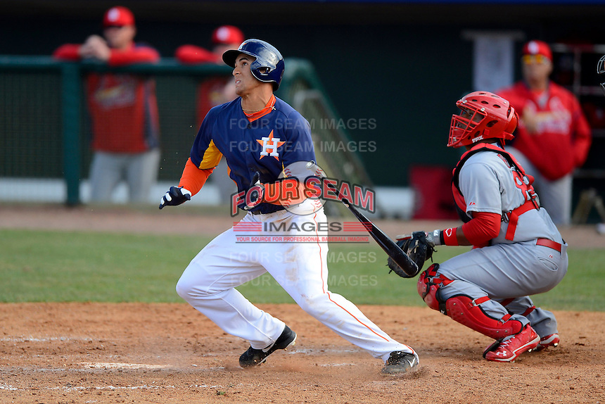Houston Astros outfielder George Springer #75 at bat in front of catcher Audrey Perez #82 during a Spring Training game against the St. Louis Cardinals at Osceola County Stadium on March 1, 2013 in Kissimmee, Florida.  The game ended in a tie at 8-8.  (Mike Janes/Four Seam Images)