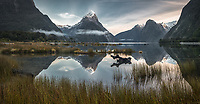 Milford Sound in winter with morning reflections of Mitre Peak 1692m, Fiordland National Park, Southland, UNESCO World Heritage Area, New Zealand, NZ