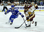 SIOUX FALLS, SD - MARCH 24: Karson Kuhlman #20 from Minnesota Duluth has the puck knocked off his stick by Zack Mirageas #74 from Air Force during their game at the 2018 West Region Men's NCAA DI Hockey Tournament at the Denny Sanford Premier Center in Sioux Falls, SD. (Photo by Dave Eggen/Inertia)