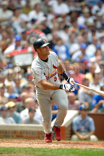 20 July 2004: St. Louis Cardinals Albert Pujols keeps an eye on the ball after hitting a home run while playing the Chicago Cubs at Wrigley Field in Chicago. St. Louis won 11-8. Photo: John Gress/Icon/actionplus...Baseball Major League MLB National League