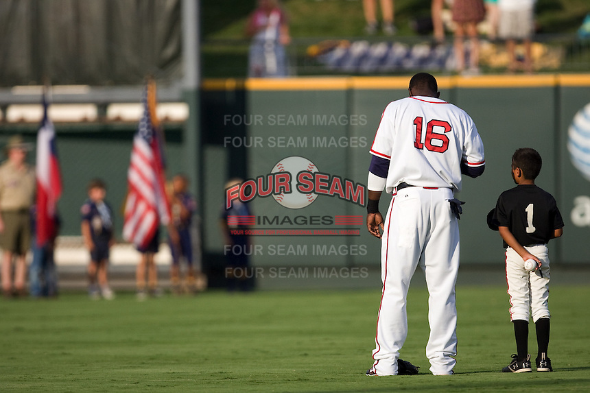 Abercrombie, Reggie National Anthem 3570 (Andrew Woolley).jpg.  PCL baseball featuring the Oklahoma City Redhawks at Round Rock Express (in throwback Austin Senators uniforms) at Dell Diamond on July 18th 2009 in Round Rock, Texas. Photo by Andrew Woolley.