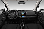 Stock photo of straight dashboard view of 2017 Toyota Yaris Y-conic 5 Door Hatchback