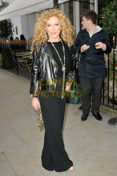KELLY HOPPEN.Kelly Hoppen book launch party for 'Kelly Hoppen Ideas' at Beach Blanket Babylon, London, England. .April 4th, 2011.full length black trousers leather jacket necklace  .CAP/CAS.©Bob Cass/Capital Pictures.
