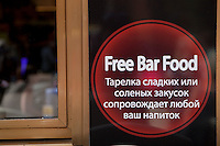Bar food sign in Russian in the window of Côté Lounge, Nice, France, 28 April 2012