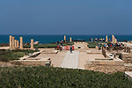 The ruins of Caesarea Maritima in Caesarea National Park in Israel.  The city was built as a port on the Mediterranean Sea by Herod the Great between 22 and 15 B.C.  In the background is the Orot Rabiin power generating station.
