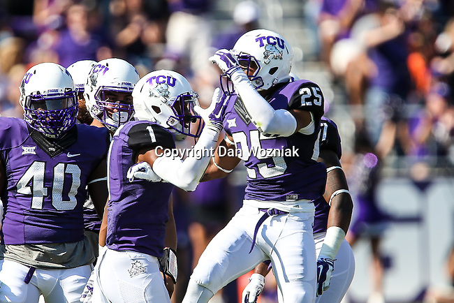 TCU Horned Frogs cornerback Kevin White (25),TCU Horned Frogs safety Chris Hackett (1) in action during the game between the OSU Cowboys and the TCU Horned Frogs at the Amon G. Carter Stadium in Fort Worth, Texas. TCU defeated OSU 42 to 9.