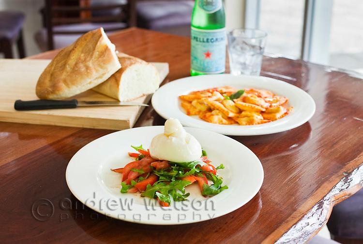 Mozarella and rocket salad, bread and ravioli at Il Convivio Deli Cafe.  Cairns, Queensland, Australia