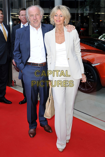 David Richards & guest .attending the McLaren Car Showroom Launch at One Hyde Park, Knightsbridge, London, England, UK, June 21st 2011..full length blue suit white trousers jacket shirt.CAP/MAR.© Martin Harris/Capital Pictures.