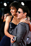 "Actor Tom Cruise and Actress Katie Holmes arrive at the Los Angeles Premiere Of ""Tropic Thunder"" at the Mann's Village Theater on August 11, 2008 in Los Angeles, California."