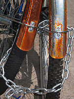 Married? A pari of rusty cruisers chained together.