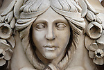 Carving of woman's face on stone urn in the Italian Gardens, Kensington Gardens, London