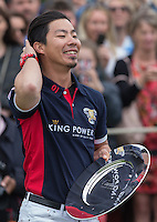 Cartier Trophy Winner Apichet Srivaddhanaprabha (King Power) with the award during the Cartier Queens Cup Final match between King Power Foxes and Dubai Polo Team at the Guards Polo Club, Smith's Lawn, Windsor, England on 14 June 2015. Photo by Andy Rowland.