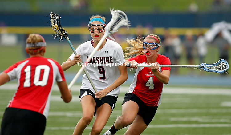 Stratford, CT-09 June 2012-060912CM02- Cheshire's Nicole Stauffer (9) moves the ball upfield as Greenich's Isabelle Mackell (4) defends during the girls lacrosse Class L finals Saturday morning at Bunnell High School in Stratford.  Greenwich won the Class L title, after upsetting number one ranked Cheshire, 9-8.   Christopher Massa Republican-American