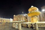 Night view of Saint Peter's square with a fountain in foreground.