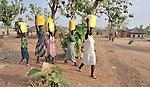 Girls in Yei, Southern Sudan, walk home after getting water from a well provided by the United Methodist Committee on Relief (UMCOR). NOTE: In July 2011, Southern Sudan became the independent country of South Sudan