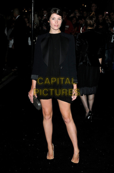 GEMMA ARTERTON.Vogue Fashion's Night Out - Giorgio Armani Party held at the Emporio Armani store, New Bond Street, London, England, UK.September 8th, 2010.full length black dress long sleeve clutch bag shoes silver.CAP/CAN.©Can Nguyen/Capital Pictures.
