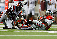 Ohio State Buckeyes quarterback J.T. Barrett (16) gets sacked by Virginia Tech Hokies defensive end Dadi Nicolas (90) in the 4th quarter at Ohio Stadium September 6, 2014. (Dispatch photo by Eric Albrecht)