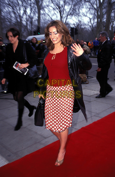 KELLY BROOK.red, leather jacket, check, waving.Ref:8204/2602i.www.capitalpictures.com.sales@capitalpictures.com.© Capital Pictures.