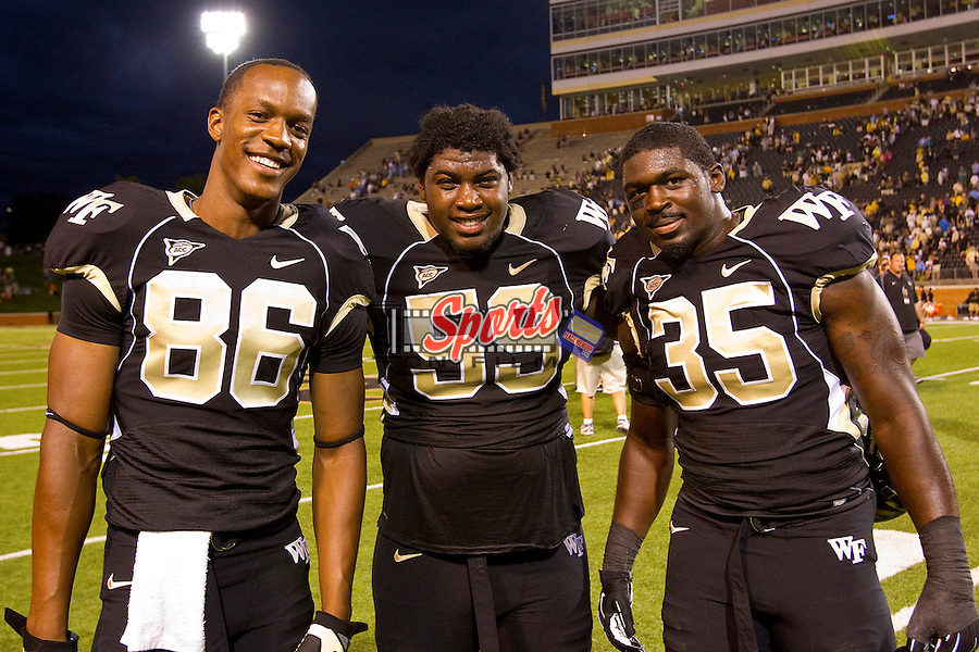 Brandon Terry (86), Antonio Ford (59) and Zachary Allen (35) of the Wake Forest Demon Deacons following their victory over the North Carolina Tar Heels at BB&T Field on September 8, 2012 in Winston-Salem, North Carolina.  The Demon Deacons defeated the Tar Heels 28-27.  (Brian Westerholt/Sports On Film)