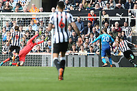 Ayoze Perez of Newcastle United (r) directs the ball past Petr Cech of Arsenal to score the equaliser during Newcastle United vs Arsenal, Premier League Football at St. James' Park on 15th April 2018